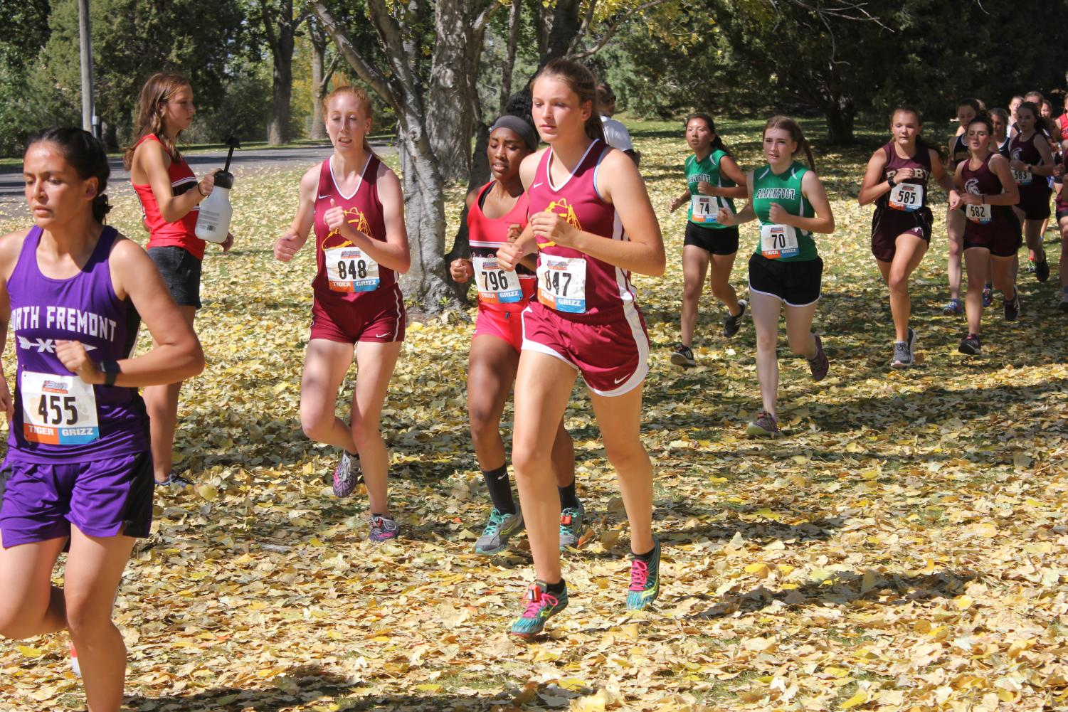 Caelyn Long and Lilly Jenkins hit their strides at the Tiger Griz Invite in Idaho Falls.