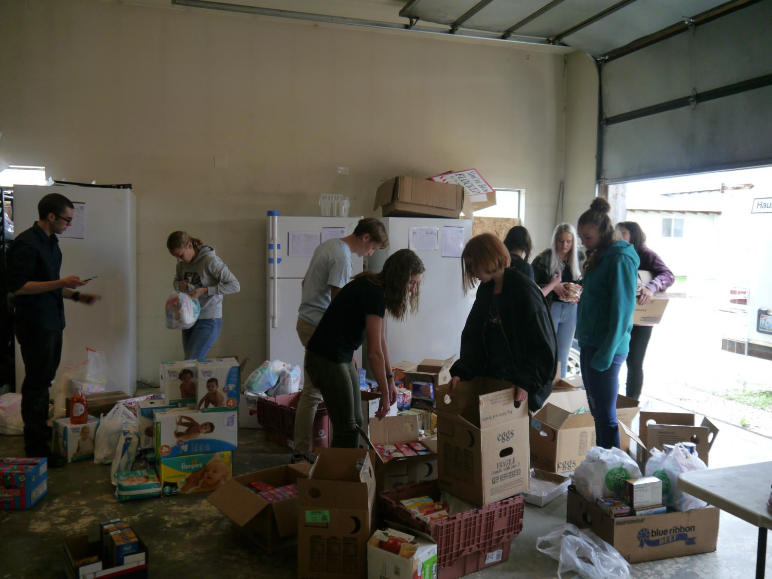Members of the National Honor Society help organize and count donations.