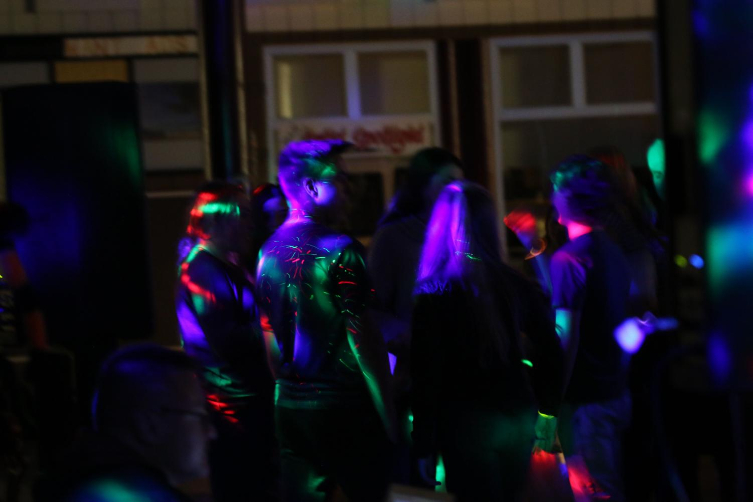BOO! Students dance and sing theirs fears away at the light-filled Halloween dance party.