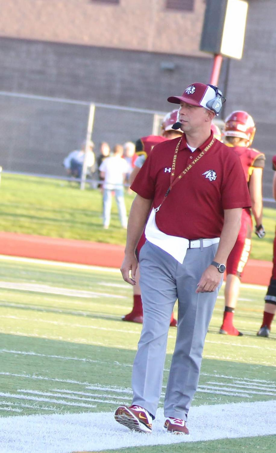 STRUTTIN: Mr. Patterson walks along the sideline scoping out the competition. Patterson has spend most his career coaching football and wrestling.