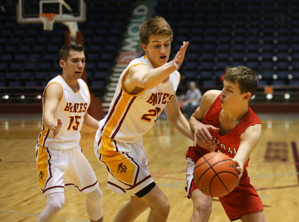 DOUBLE TEAM: Tanner Thompson and Mason Erickson look to shut down a Cheyenne Central passer in the Events Center in Casper, WY at the state tournament. Photo by Jacob Byk/WY Tribune Eagle.