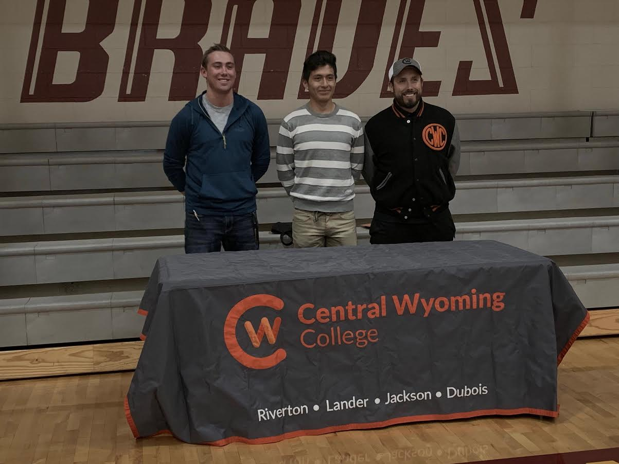 SMILES ALL AROUND: Former SVHS athlete Noah Hutchinson and Senior Gerson Lozano smile alongside Central Wyoming Recruiter.