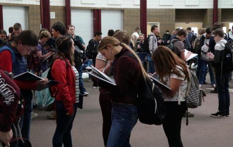 Students Receive Yearbook, Sign Madly