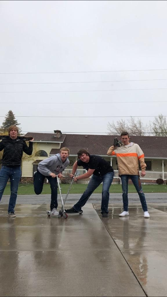 LUNCH TIME FUN TIME: Branden McDonald, RJ Cazier, Taylor Horsley, and Hazen Erickson enjoy their lunchtime while their underclassmates sit in homeroom.