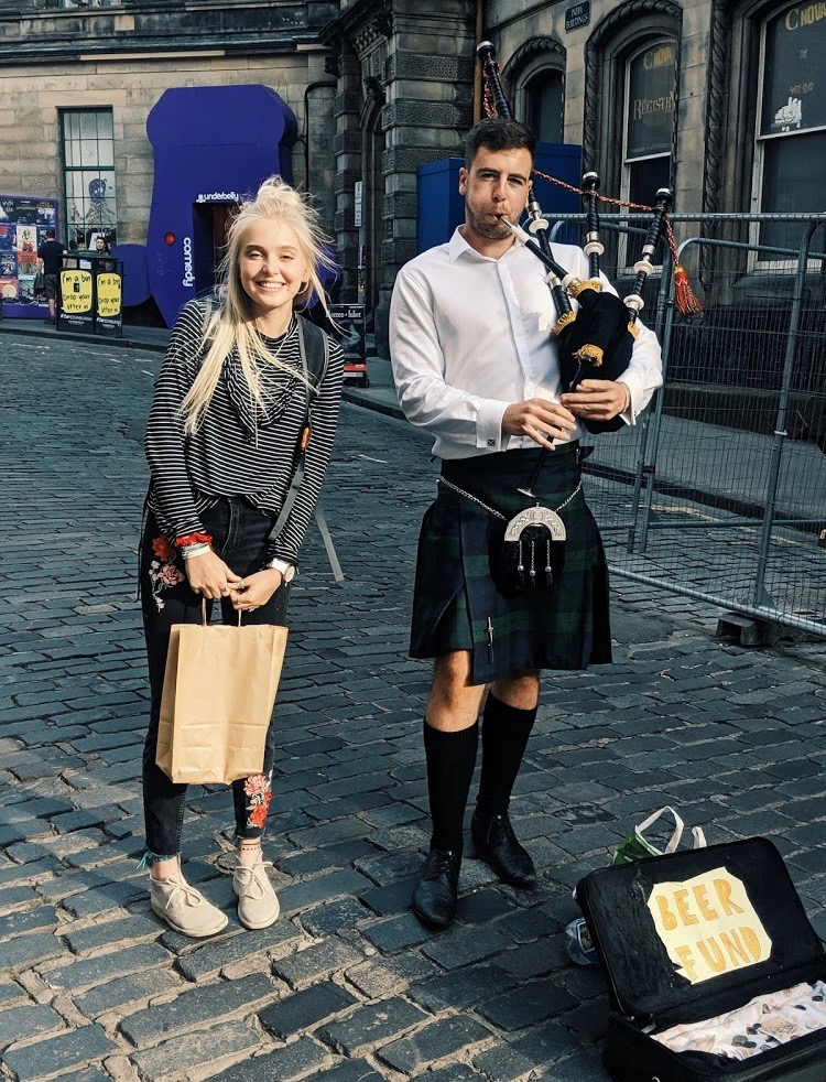 STREET PIPES: Emma Graham approaches a genuine bagpiper on the streets of Edinburgh, Scotland. She spent a large part of her summer break living with and working for a host family in the country.