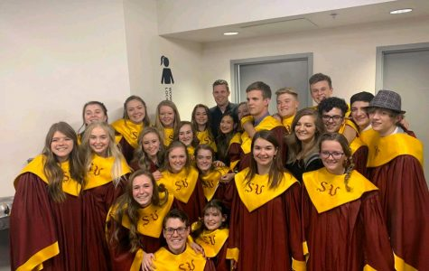 """LET THE CHOIR SING! Choir students gather together for a group photo at all-state competition in Gillette held on Jan 19-22nd. """"I thought it was awesome to be singing with 170 kids who all cared and wanted to be there,"""" said senior Makia Haderlie."""