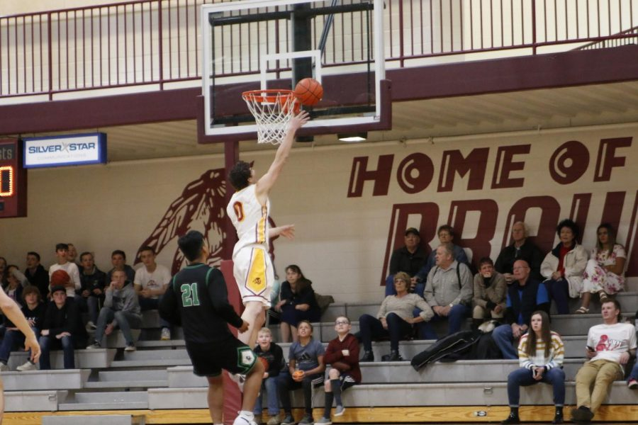 DUNKIN: Chase Merrell gets up to throw down on a Blackfoot defender.