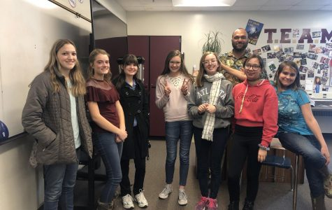 ALL SMILES: Members of the Anime Club and supervisor Mr. Lusuma assemble for their first meeting. The club is always open to new members.
