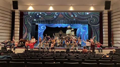 TAA-DAA: Musical cast members show their excitement for opening night in this big dance number. Photo By: Gina Fullmer
