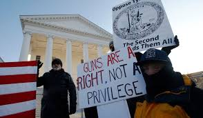 SHOOT! Protestors gather in Virginia to protest against a new law in their state that they feel curtails the rights of gun owners.