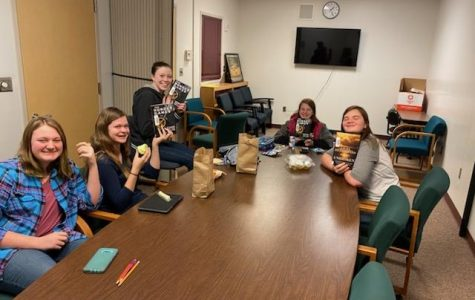 BOOK WORMS: The book club meets every Monday at lunch time and are reading The Hunger Games right now.