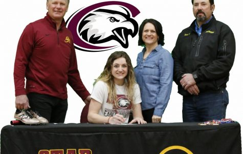 COMMITTED: Hannah Christie poses with her parents and jumping coach Ballard Johnson Feb 25th after signing a letter of intent with Chadron State for track.