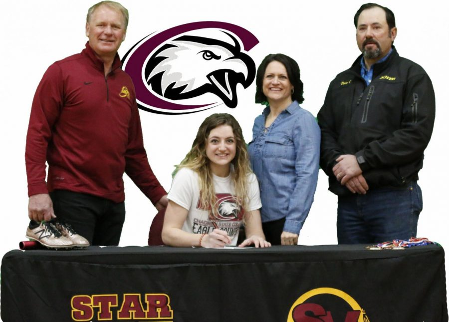 COMMITTED%3A+Hannah+Christie+poses+with+her+parents+and+jumping+coach+Ballard+Johnson+Feb+25th+after+signing+a+letter+of+intent+with+Chadron+State+for+track.+