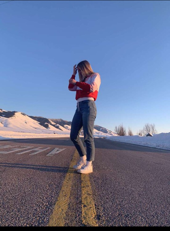 MODEL BEHAVIOR: Junior Libbi Erickson strikes a pose in the road to make for the perfect picture to flex her fit.