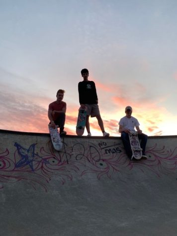 CHILLIN': Seniors Cael Delgado (left) Dakota Passey (middle), and Spencer Larson (right) do more posing than actual skating.
