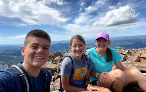 ADVENTURE: Juniors Preston Buehler, Sara Mcken, and Emmalee Hale enjoy the view after their long hike up Wagner Peak, one of Hale's many hikes of the summer.