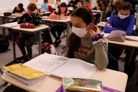 NEW WAYS NEW THOUGHTS: Students study while masked up. Masks have joined notebooks and iPads as the most common things seen in the classroom.