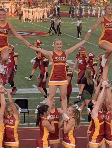 SPIRIT SPECIALISTS: The cheerleaders do what they do best at the first football game.