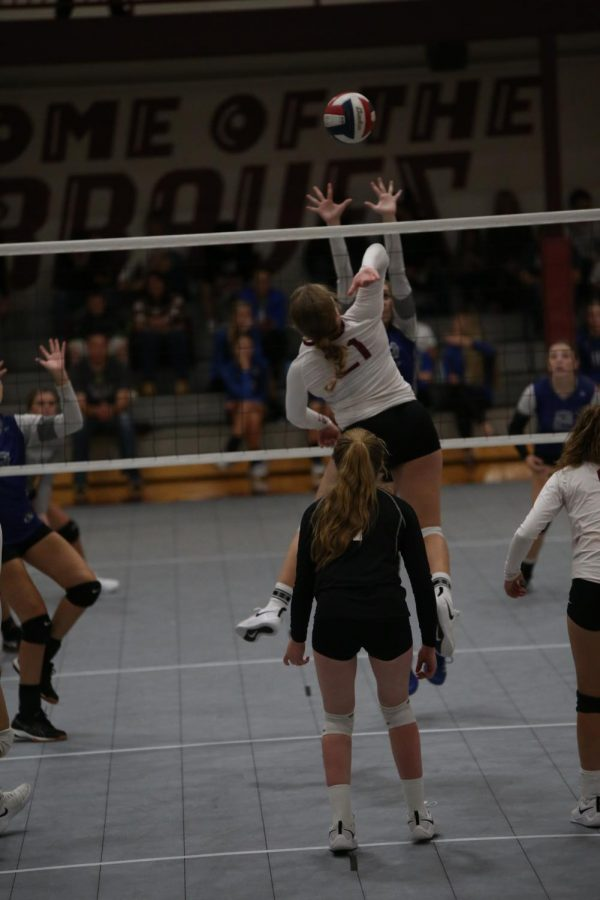 """NOTHING BUT NET: Gracee Cazier gets ready to kill the ball against Sugar Salem. Cazier is excited about this year because """"our team is so close which makes us have a lot more fun on the court."""""""