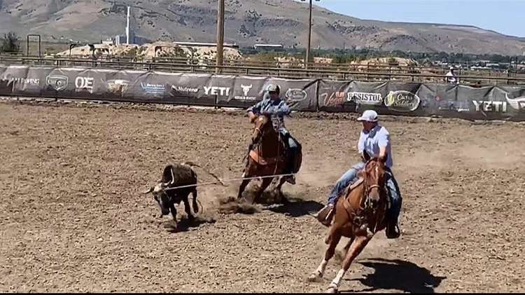 HEEL%21+Kortlen+Hilton+looks+to+catch+the+heels+of+a+charging+steer+while+team+roping+with+his+brother+Tristen.+Kortlen+recently+won+a+Polaris+side+by+side+for+his+efforts+with+a+rope+on+horseback.%C2%A0