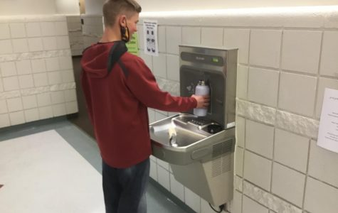 HGH QUALITY H20: Kash Lancaster fills up his water bottle in between class at one of the new filling stations.