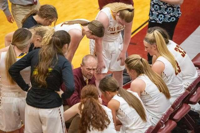 "Kade Wilkes coaching the girls during a time out. All the girls love him and how encouraging he is. Emri Jenkins said, ""He always gives people a hard time, but he loves everyone."""