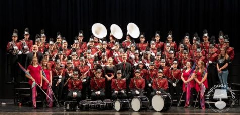 BANDED: Marching band gathers for a formal picture, showing the unity that made them excellent on the field.