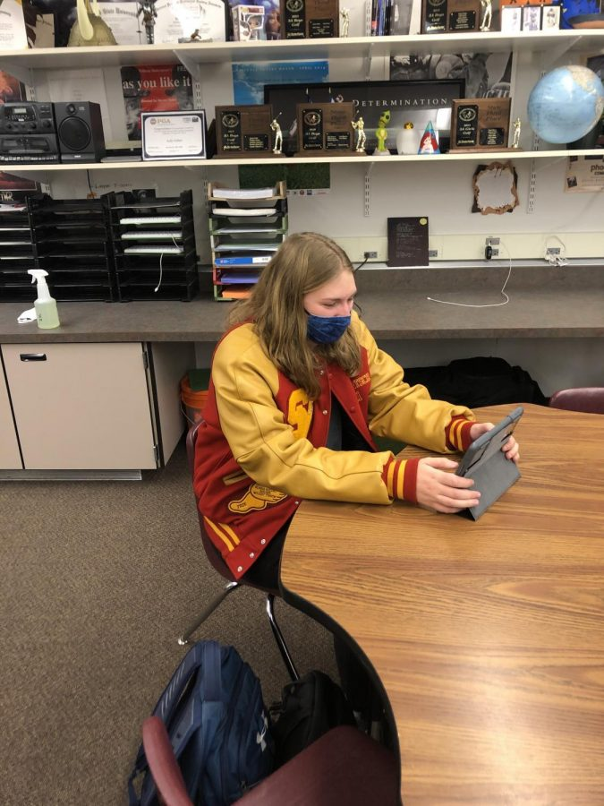 REPPIN': Senior Emily Gertsch keep warm in English class, showing style and school spirit in her letterman's jacket. Gertsch earned all her letters in track and plans to earn more.