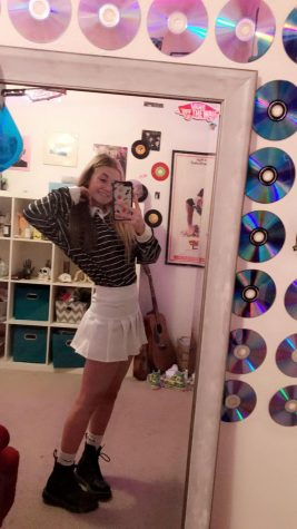 READY: Junior Kaiya Hornung shows off her best outfit in her bedroom mirror.