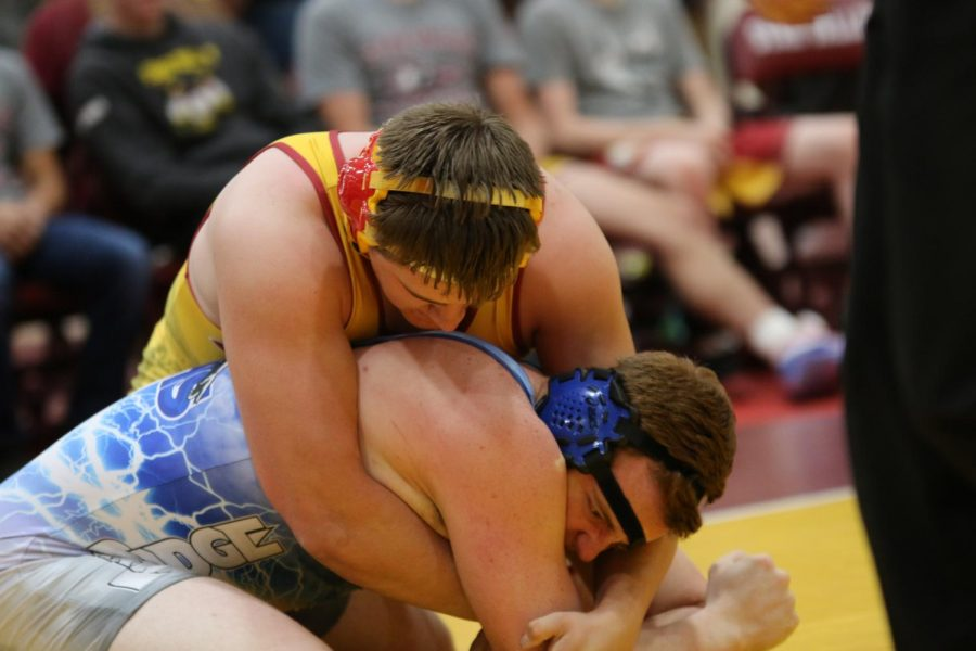 BEAR HUG: Kysen Hebdon gets his opponent in a tight clinch at the Braves Brawl.