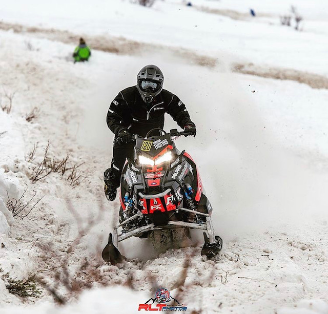 RIPPIN IT UP: Tanner Thomas looks ahead as he zooms up a mountain during a hill climbing competition.