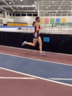 ZOOM: Emmalee Hale speeds around the corner of an indoor track.