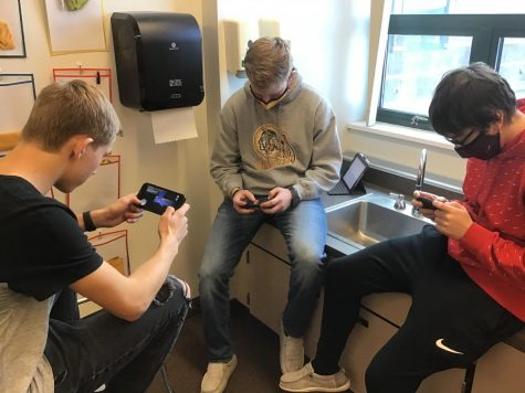 """AMONG US: Juniors Dylan Johnson, Mason Brown, and Hayden Burton play Among Us after they are done working in class. """"I play in class all the time, and that"""