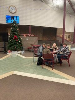 TANNENBAUM: Students relax in the commons in the glow of the school Christmas Tree.