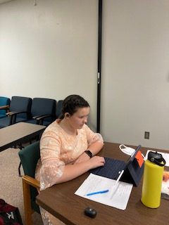 HARD AT IT: Freshman Maggie Daniel competes in a virtual speech meet in the category of congress.