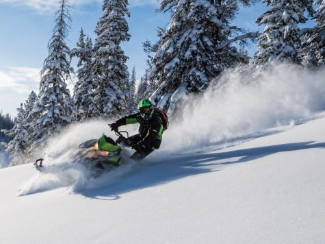"POWDERPUFF: The snowmobile was called a motor toboggan when it was first invented. ""I like to do it with my family because I like pulling around my siblings,"" said Richards. 230,000 miles of marked snowmobile trails in the United States and Canada demonstrate the popularity of this winter activity."