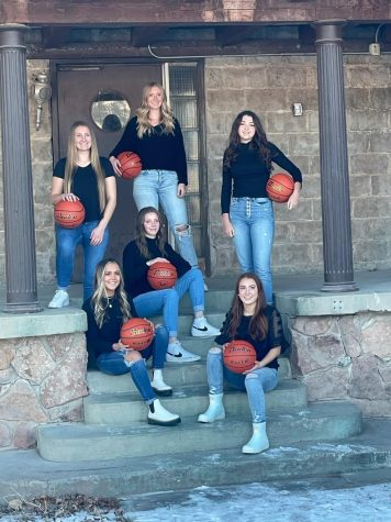 "LAST SEASON: The senior Lady Braves assemble, looking as good off the court as on. Page Nield, pictured with her team, will miss this season due to a knee injury. ""It sucks that I can't play, and I'm sad about it, but I'm glad I can still travel with them and support them,"" said Nield."
