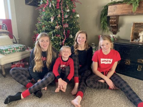 "SANTAS COMING: The Hale household shows off their pajamas. Maddie Hale said, "" My family was matching this year, and I thought they were really cute. I will wear them more than just Christmas Eve."""