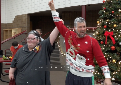 VICTORY: Mr. Frazier joins senior Chance Williams and mistakenly holds up one finger. Two fingers would have more accurately reflected his effort as Frazier lost the pre-Christmas bikie race through the building to Williams.