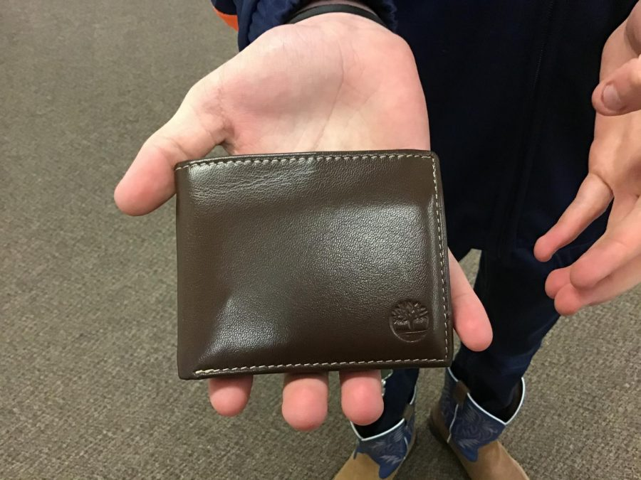 PAID: Two of the most popular wallet colors are brown and black. Bradyn Jenkins received a very nice brown, leather wallet for Christmas. Wallets can hold cash and change as well as personal items.