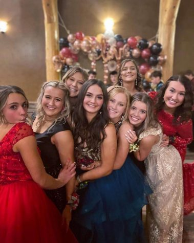 "BEAUTIFUL: Looking pretty in their dresses, these sophomores had a great time at their dances. ""My date was Gavin Bassett, one of my close friends. My favorite part was probably dancing with my friends and getting to experience my first high school type dance!"" said Josie Linford."