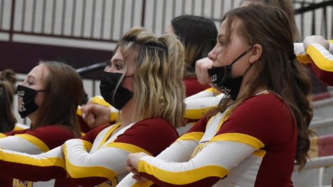 "CHEER UP: Junior Karlee Cassidy and sophomores Auderie Hansen and Bently Bowcut show their sprit and social responsibility while repping the masks  and cheering for the Braves. ""When we"