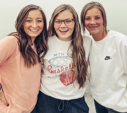"BESTIES: Seniors McKenna and McKayla Brog pose to the side of sophmore Cameron Erickson. These three have always been friends but started to get even closer this year. ""I think Cam and I would always be friends even in the same grade,"" said McKayla Brog."