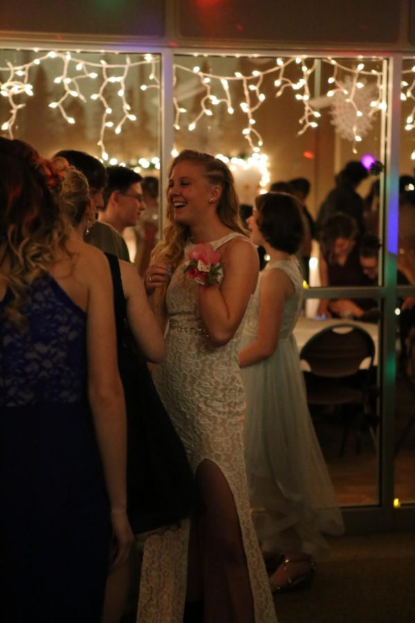 "WINTER FORMAL: Libbi Erickson, now a Senior, chats it up at the 2019 Winter Formal. ""I'm sad that we can't have dances anymore, especially now that it is my senior year, but this week it still going to be super fun!"""