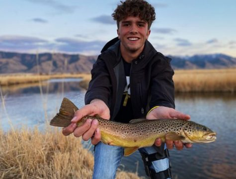 FISH AND PERMS: Junior Zach Patterson showing off his perm and his great catch.