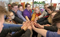 GO TEAM: Speech and debate team  members huddle up after a good day of practice.