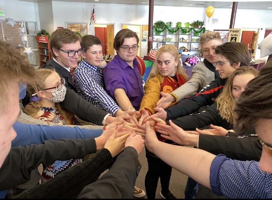 GO+TEAM%3A+Speech+and+debate+team++members+huddle+up+after+a+good+day+of+practice.