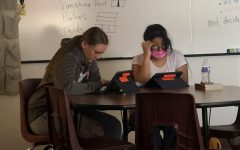 HOME BODIES: Freshmen Allie Jack and Stacey Perez work diligently in home. Their homeroom teacher, Mr. Fullmer, said,
