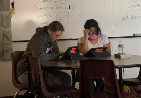 """HOME BODIES: Freshmen Allie Jack and Stacey Perez work diligently in home. Their homeroom teacher, Mr. Fullmer, said, """"Stacey and Allie work almost everyday in homeroom. They are model students."""""""