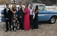 """TRUCKIN': Seniors pose for a picture at the 2019  prom. Aubree Pierson said, """" I love hanging out with my friends and getting all dressed up. It is especially fun to get ready with all my best friends before."""" The group hopes to recreate the picture at this year's prom."""